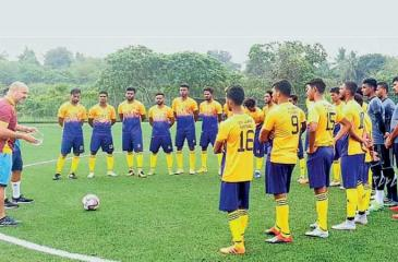 Sri Lanka football players listen to a lecture by head coach Amir Alagic