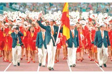 Then Prince, now King of Spain, Philip VI leads the Spanish Olympic team as the flag bearer at the Opening Ceremony