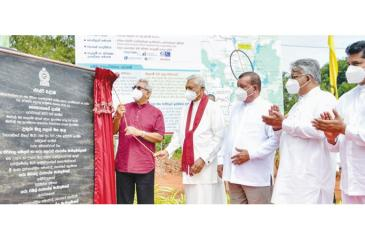 President Gotabaya Rajapaksa unveils the plaque of the proposed irrigation tunnel flanked by ministers and other officials