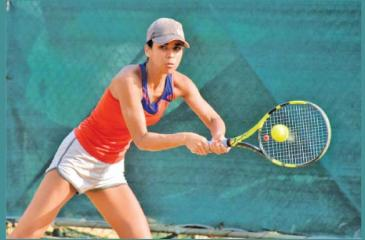 Anika Seneviratne plays a back hand stroke