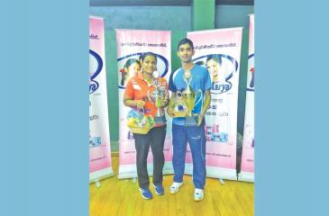 Chameera Ginige the men's winner (right) and Ishara Madurangi the women's champion pose with their trophies