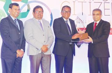 Chairman, Ceylon Chamber of Commerce, Dr. Hans Wijayasuriya presents one of the awards to SLT CEO Kiththi Perera. (From left): Head of Judging Panel, Dr. Ananda Mallawatantri and SLT COO Priyantha Fernandez look on.