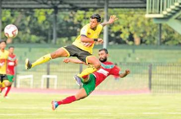 File photo of Colombo Football Club (in yellow) and New Youngs Wennappuwa (red) in action during their warm-up match ahead of the Super Premier League scheduled to start on April 18
