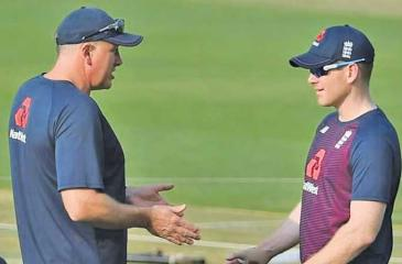 England coach Chris Silverwood (left) talks to captain Eoin Morgan
