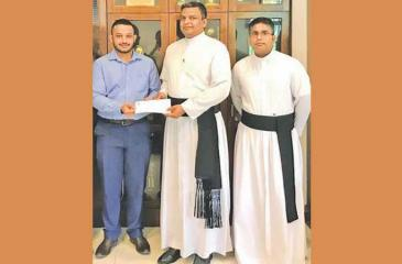 From left: Senel Rohana, Rev. Fr. Rohitha Rodrigo (Rector) and Rev. Fr. Chanaka Jansze at the launching of the scholarship in memory of the late tennis master in charge of St. Peter's College Bernard Jesudasan
