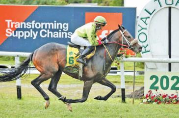 Jockey Vivek rides Western Wind to win the Governor's Cup