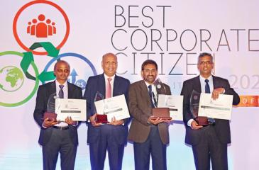 "The Bank of Ceylon General Manager D.P.K. Gunasekera (middle) with the Award received for Bank of Ceylon as ""one of the Top Ten Best Corporate Citizens"" in Sri Lanka. (L to R) AGM Human Resource K.A.D. Wijayawardena, DGM Human ResourceK.E.D. Sumanasiri and DGM Finance and PlanningM.P. Ruwan Kumara are also in the picture with three category awards received for the Bank."