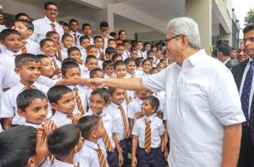 President Gotabaya Rajapaksa  greets a student during  the Gama Samaga Pilisandara program.