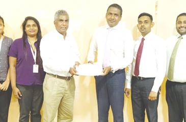 After signing the agreement. Head of Marketing - Customer Retention and Growth, Finetech,  Chamathka Fernando,  Head of Change Management and Software Engineering, Finetech, Ranisha Shalinki,  Director and CEO, Finetech, Clehan Pulle, CEO, SDF,  Nilantha Jayanetti, Chief Manager Finance, SDF, Mahesh Jayasanka, and Head of IT, SDF, Dilshan Dissanayake