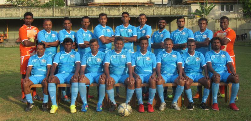 Colombo Veterans (squad) seated from left: Priyantha Liyanage, Joseph Shanthakumar (Rasa), M.W.M. Hisham, M.S.M. Faiz (coach cum player), R. Puvanenthiran (President CVFC), Jayashantha Liyanage, Jagath Rohan, Maxie Lattren (back row), Dhammika Senerath (GK), Roshan Peiris, Vijaya Baskar, Mohammed Imthishan, Prasanna Hettiarachchi, R.S. Pradeep, Sisira Kumara, Mohammed Ikram, Mohammed Ismirly, Jeewantha Ratnayake and Samantha Perera (GK). Absent: M.H. Rumy (Captain)