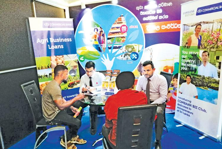 Visitors to the Enterprise Sri Lanka exhibition in Moneragala at the Commercial Bank stall.