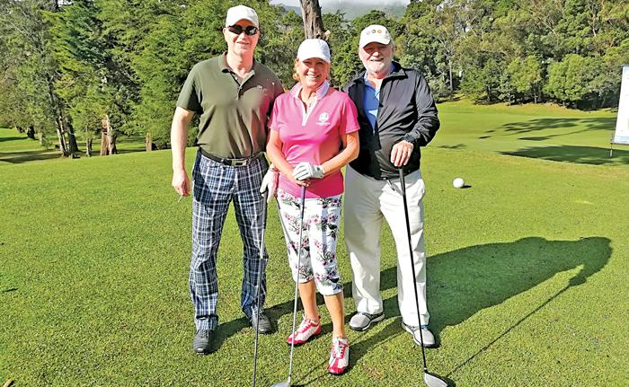 "Hans Jorg of 'Zunderorf"" magazine, Elsa Mary Honecker of the Connoisseur Circle and the Golf Yearbook, Bernd Stegmaier Editor in chief of 'Golfen' magazine at the Nuwara Eliya golf course"