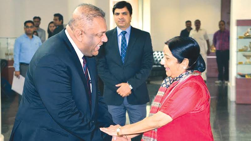 Indian Foreign Minister Sushma Swaraj welcomes her Sri Lankan counterpart Mangala Samaraweera in New Delhi last week