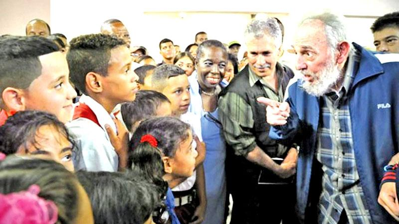 Havana: This photo taken on April 12, 2013 and published in the Cuban  official website www.cubadebate.cu shows former President Fidel Castro talking to children during the inauguration of a school in Havana. Cuban revolutionary icon Fidel Castro  died on Saturday, his brother announced on  national television. – AFP