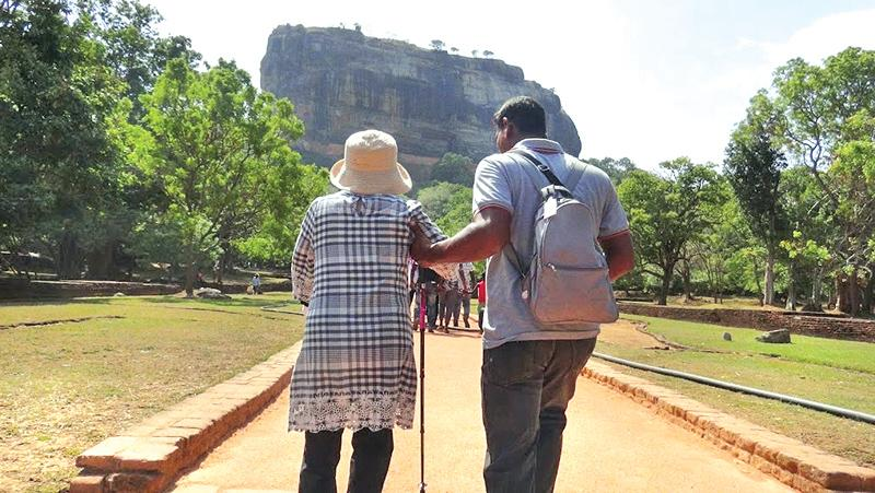 An elderly foreign tourist being 'escorted'