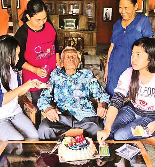 Attending his party were Mr. Suwarni with their children Erika Kurniawati and Anisa Kurniawati (Donal Husni/ZUMA Wire/REX/Shutterstock)