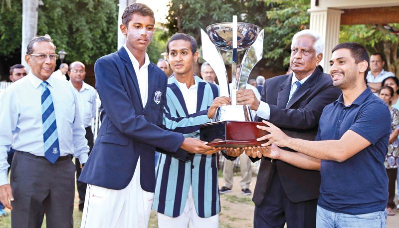 The  two captains  Hiran Cooray (L)(St.Joseph's) and  Shamod Athulathmudali (Wesley) sharing  the Bryan Classen  trophy  handed  over by old  Wesleyite and  former Sri  Lanka  paceman  L.R.Gunatileka in  the  drawn  centenary  encounter at  Campbell Park  yesterday.      Pic : Thilak Perera