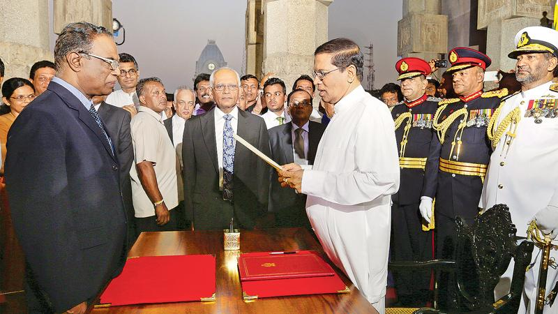 Taking the oath as the President before Chief Justice K. Sripavan