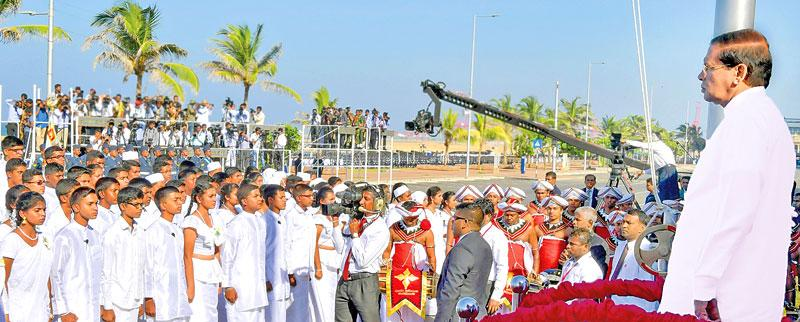 President Maithripala Sirisena stands to attention while the students recite Jayamangala Gatha during the 69th Independence Anniversary celebrations at the Galle Face Green.         (Pic Sudath Malaweera)