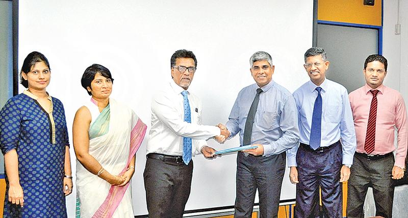 From left: Group Manager Legal, Asiri Group of Hospitals, Nadeeka Wimalathunga, Director Operations, Asiri Group of Hospitals, Dr. Samanthi de Silva, CEO, Asiri Group of Hospitals, Dr. Manjula Karunarathne, COO, National Insurance Trust Fund, Sanath C. de Silva, Chairman, National Insurance Trust Fund, Manjula de Silva and Asst Manager, Agrahara, Anura Samarakoon at the signing of the MoU.