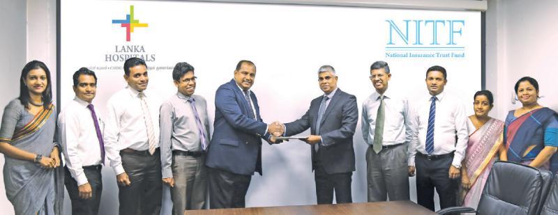 From left – Nuwanthi Gunewardena – Manager Legal, Lanka Hospitals PLC,  Thanujaya Gunasekara - Assistant Manager Marketing, Lanka Hospitals PLC, Nimal Rathnayake - Chief Marketing Officer, Lanka Hospitals PLC , Dr. Prasad Medawatte - Group Chief  Executive Officer, Lanka Hospitals PLC, Lanka Hospitals & Diagnostics, Sanath C De Silva - Chief Executive Officer, NITF, Manjula De Silva - Chairman NITF, Anura Samarakoon- Assistant Manager, Agrahara, Nimali Perera - Manager (Branch Supervision) & Udari Ranhotiga