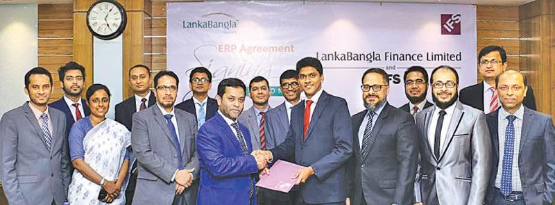 Asanga Marasinghe, Country Director IFS Bangladesh handing over the agreement to Mohammed Nasir Uddin Chowdhury, Managing Director LankaBangla Finance Limited (LBFL) as Shiraz Lye, Director Sales & Marketing, IFS South-Asia, Zahid Khan, Head of Operations, IFS Bangladesh, Sheik Mohammad Fuad, Head of IT/LBFL, Khwaja Shahriar, Deputy Managing Director of LBFL, Shamim Al Mamun, Chief Financial Officer of LBFL, A. K. M. Kamruzzaman, Head of Operations of LBFL and other officials looks on