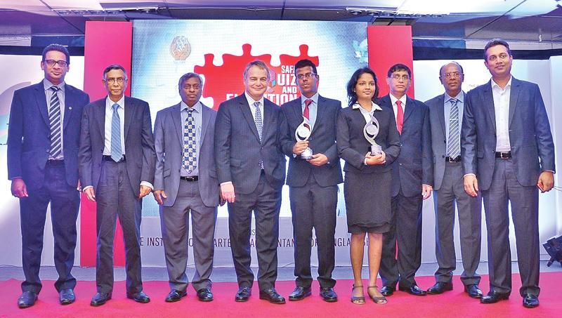 Ravindi Sandini and Hakeem Halwan with their awards. President of the International Accounting Standards Board (IASB), Hans Hoogervorst, President of CA Sri Lanka, Lasantha Wickremasinghe and Vice President Jagath Perera look on.
