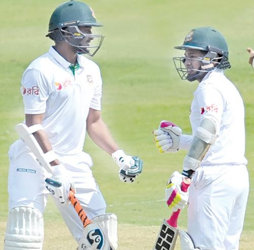 Bangladesh captain Mushfiqur Rahim and Shakib Al Hasan have a mid pitch chat during the third day of the first Test against India at Hyderabad on Saturday. AFP