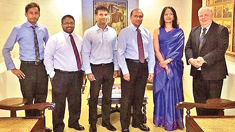 Officials of JKH and CAMMS at the signing ceremony. From left: Senior Manager, Business Development, Asia, CAMMS, Shane Herath, General Manager, Asia - CAMMS, Sanharsha Jayatissa, Head of Sustainability, Enterprise Risk Management and Group Initiatives, JKHI, Isuru Gunasekera, Group Finance Director, JKH, Ronnie Peiris, President, Legal, HR, Sustainability, Enterprise Risk Management and Group Initiatives, JKH, Dilani Alagaratnam and Managing Director, CAMMS, Joe Collins