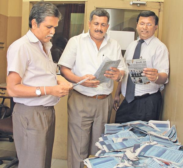 Picking the  lucky winners. From left. Kapila Ajith Kumara (Head  Of  IT ANCL), Kamal Wijesuriya ( DGM Printing  And Maintenence ANCL) and Narada Sumanaratne( DGM Human Capital) picking  the  lucky  coupons  at  the  end  of  the  third  week  count.
