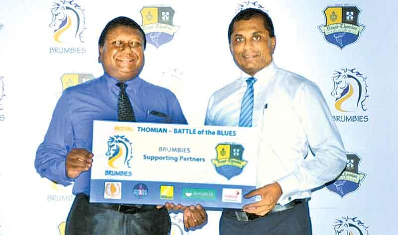 Executive Director of George Steuart Health, Eran Ranasinghe presents the sponsorship package to President of Brumbies - 2017, Surath Silva in support of the Brumbies enclosure.