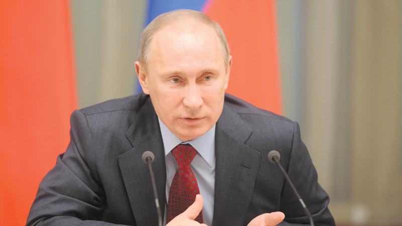 Russia's Prime Minister Vladimir Putin speaks as he meets university and college rectors in the government headquarters in Moscow, on February 14, 2012. After serving two consecutive presidential terms between 2000 and 2008 and a term as prime minister, Putin is seeking a third term. AFP PHOTO