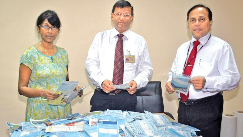 Picking the winners. From left. Chandani Jayatileka ( Associate Editor Sunday Observer), Narada Sumanaratne ( DGM Human Capital ,ANCL ), and Waruna Mallawarachchi ( DGM Advertising) picking the winning coupons.