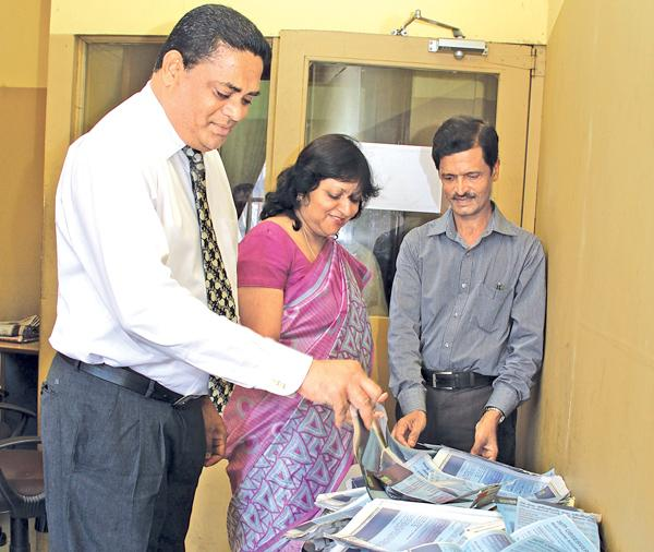 From left. Viraj Boise (DGM Finance),  Mrs.Kumudu Gunawardene (Company Secretary ANCL) and Jagath Hewapanna (Editor Mihira)  picking  the  lucky  reader's  coupon at  the  6th week  draw