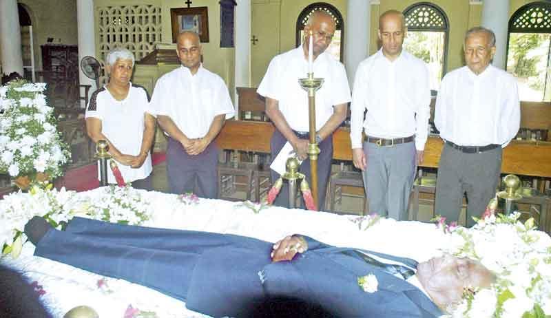 PICTURES BY - HERBERT PERERA From left: Mrs. Nedra Wijeratne (Daughter), Rohan Wijesinha (Son), Dameshk Wijesinha (Son), Vernon Tissera (a pupil of  Berty Wijesinha) paying their last respect.