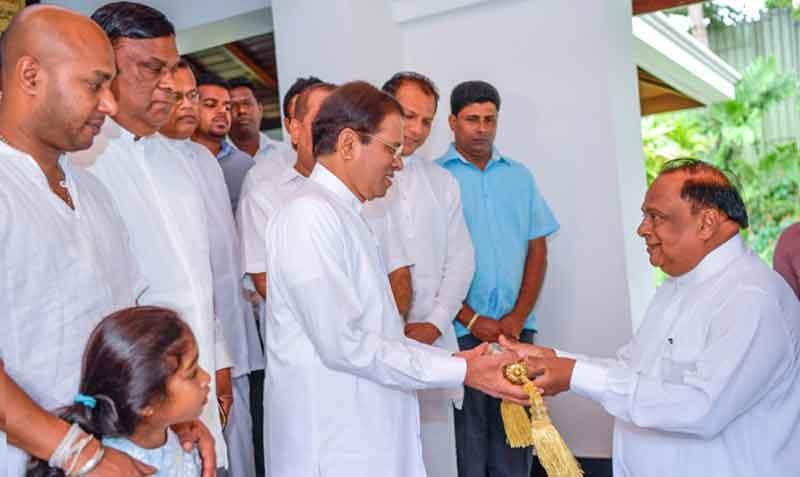 Cultural Affairs Minister S.B. Navinna presents the Avurudu Neketh seettuwa to President Maithripala Sirisena