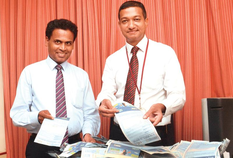 Head of Corporate Planning, Lake House, Sumith Kothalawela (right) and Head of Fund Management, D.M. Danasena picking the lucky coupons among the winners at the end of the 10th week count. Pic. Wimal Karunatileka