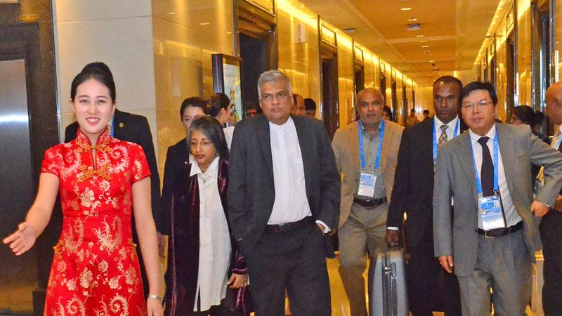 PM Ranil Wickremesinghe and Prof. Maithree Wickremesinghe being welcomed at the Capital International Airport in Beijing last evening. The PM arrived in Beijing to take part in the 'One Belt, One Road' summit.