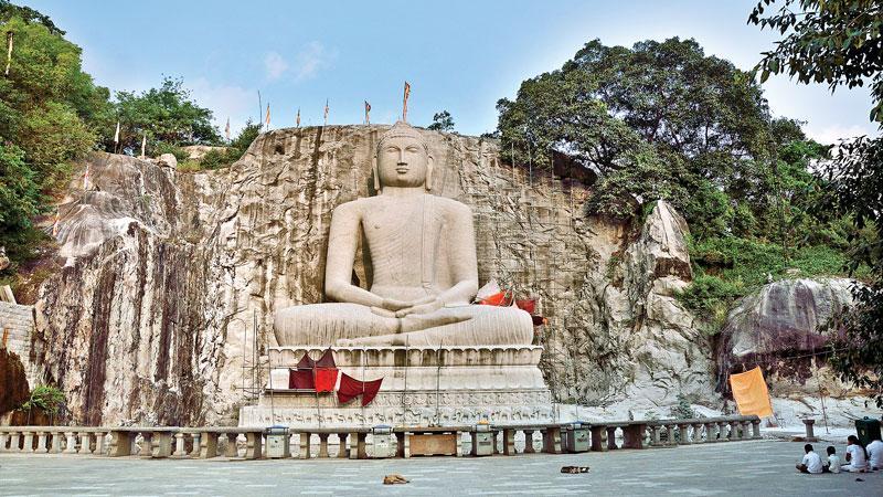 The towering rock-cut Samadhi Buddha statue at Rambadagalla