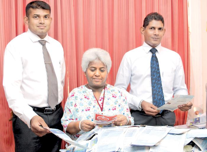 Picking the lucky winning coupons: (From left) Suranga Dalugoda (Manager Advertising), Mrs. Dehini Pathirana (Senior Journalist - Sunday Observer Editorial) and Ajith Fernando (Manager Cash Department) with the winning coupons at the 14th week draw. Pic Lionel Perera