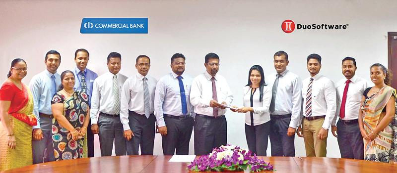 Commercial Bank Assistant General Manager – IT Krishan Gamage exchanging the agreement with Duo Software (Pvt.) Ltd. CFO/ Director Jennifer Samuel Perera. From left: Commercial Bank Head of Operations Priyanthi Perera, Manager,  Procurement Department, Rangika Rodrigo, Manager, Digital Banking, Sonali Gunasekara, Head of Card Centre, Thusitha Suraweera, AGM, Services, Chinthaka Dharmasena, AGM, Operations S. Prabagar, Manager, IT Operations, Thilan Jayathilake, AGM, IT, Krishan Gamage, Duo Software CFO/ Dir