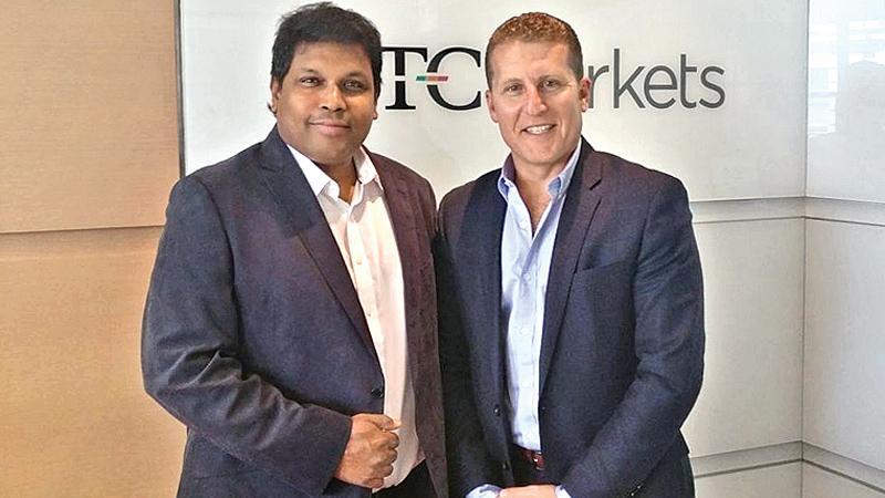 Duo World Inc. Founder and CEO Muhunthan Canagasooryam (left) with OTC Markets, Executive Vice President Jason Paltrowoitz.