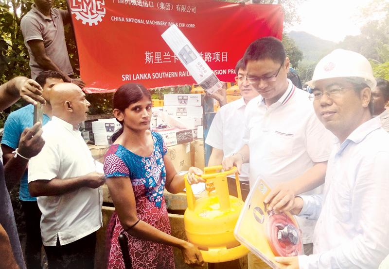 A resident of Pelawatta in Morawaka receives a gas cooker and cylinder.