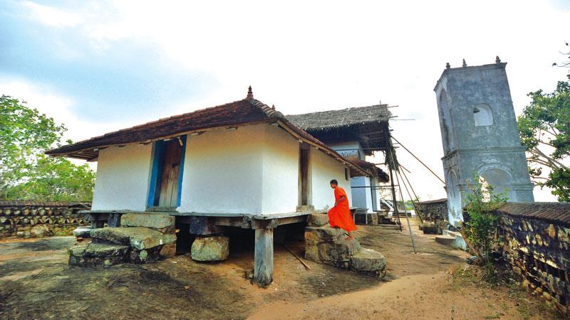 Bihalpola 'Tampita Vihara' built on wooden beams on a rock boulder stands majestically on the summit of the hill