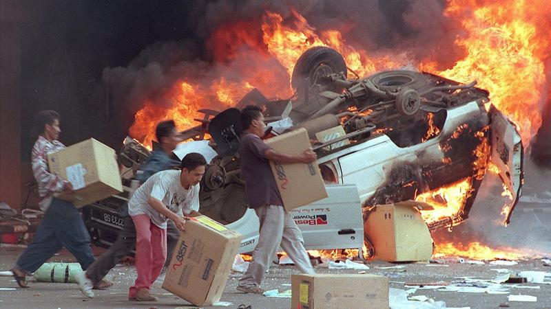 Burning and looting by people in Indonesia in 1997.  FILE PIC: WWW.BBC.CO.UK