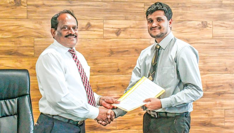 Dr. E. A. Weerasinghe, the Vice Chancellor of NSBM and Jananga Piyadasa, Business Analyst of MTI Consulting exchanging the signed MoUs at the signing ceremony held at NSBM Green University Town, Pitipana, Homagama.