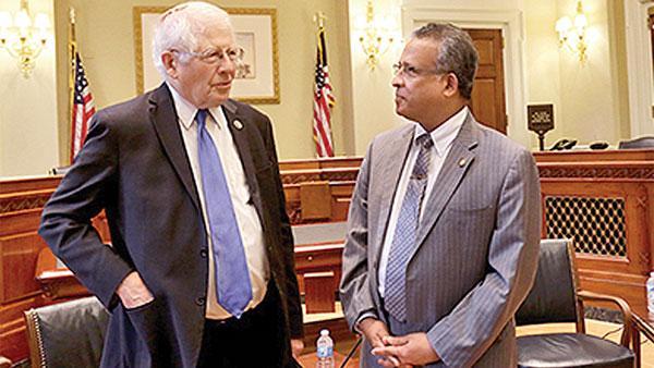 Sri Lanka Ambassador in the USA, Prasad Kariyawasam in conversation with a US statesman.