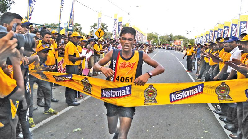 The winner of the 'Nestomalt Mini Marathon'S. Kirthushan is seen crossing the finishing line eight minutes ahead of the other athletes.Picture by Thilak Perera in Jaffna