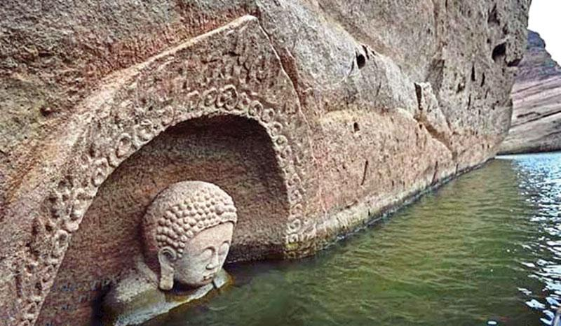 A file photo shows the head of the Buddha was spotted at Hongmen Reservoir in the city of Fuzhou.  Pic/Xinhua