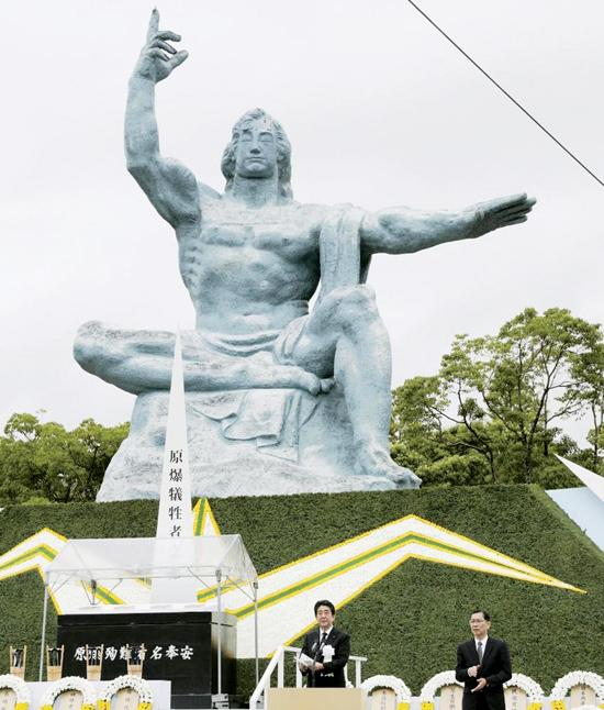 Prime Minister Shinzo Abe speaks in front of a memorial statue in Nagasaki during a ceremony to mark the 72nd  anniversary of the atomic bombing of the city. Pic: KYODO